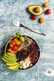 Lunch bowl of quinoa tricolore, chard, avocado, carrot spaghetti, tomatoes and feta - SARF03288