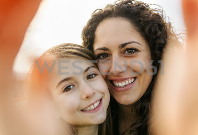 Happy mother and daughter taking a selfie - MGOF03227