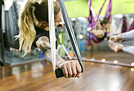 Group of women having a class of aerial yoga - MGOF03245