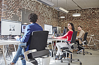 Group of people working in creative office, looking content - RHF01851