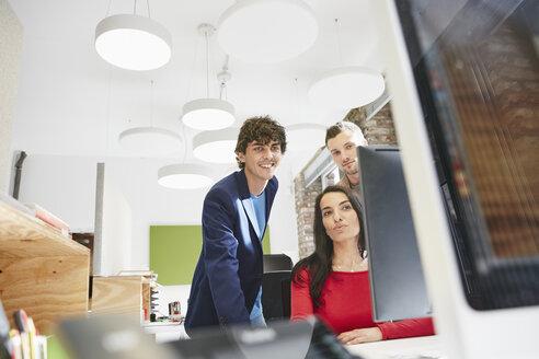 Creative team working together , using computer - RHF01857