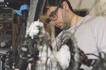 Bicycle mechanic changing rear suspension - SKCF00288