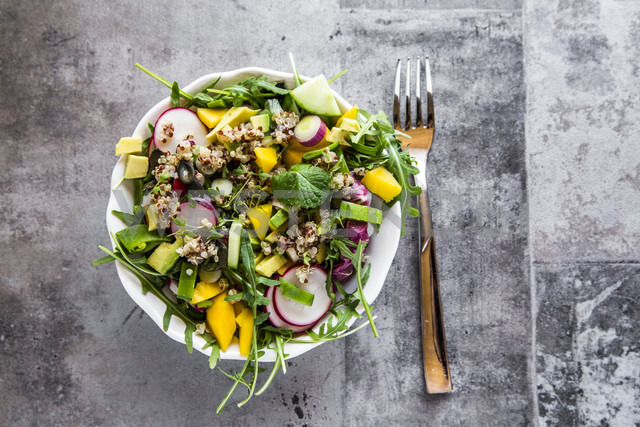 Mango quinoa salad with rocket, avocado, cucumber, red radishes and pumpkin seeds - SARF03294