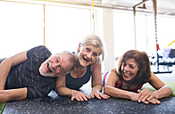 Senior friends having fun in gym - HAPF01456