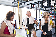 Group of fit seniors in gym taking a break - HAPF01459
