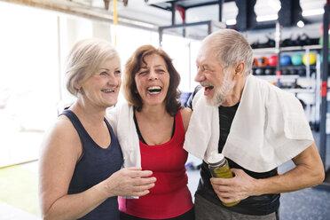 Group of happy seniors in gym taking a break - HAPF01462