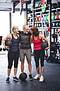 Group of fit seniors with medicine balls in gym - HAPF01480