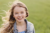 Portrait of smiling girl with blowing hair - NMSF00046