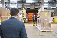 Three men in factory warehouse - DIGF01749