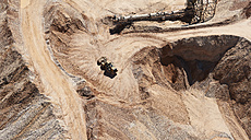 USA, Texas, aerial view of sand mine near San Antonio with a grader moving sand - BCDF00269