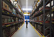Businessman on the phone in factory storehouse - DIGF01878