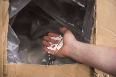 Close-up of hand with packing material - DIGF01967