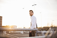 Portrait of young businessman  at sunset - DIGF02006