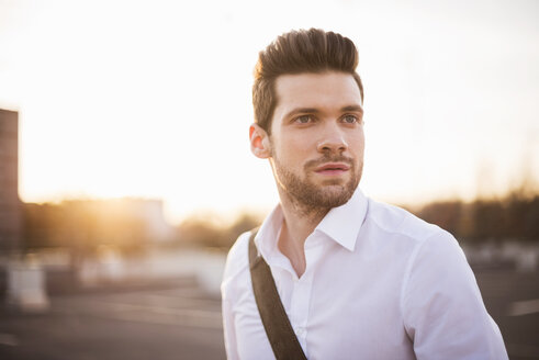 Portrait of young businessman  at sunset - DIGF02009
