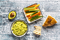 Bowl of avocado hummus, crudites, avocado and flat bread - SARF03305