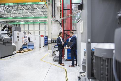 Two businessmen in factory shop floor - DIGF02068