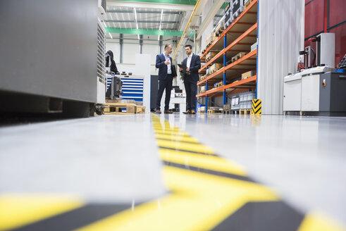 Two businessmen in factory shop floor - DIGF02071