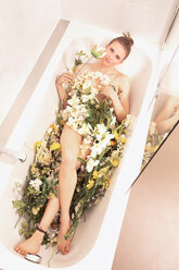 Young woman lying in flower bath - FCF01185
