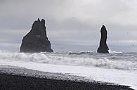 Iceland, Vik, stone trolls at Reynisfjara beach - RAEF01852