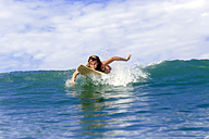 Surfer paddling on the sea - KNTF00833
