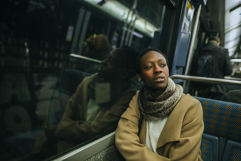 Portrait of young woman in underground train - KIJF01405