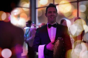 Smiling elegant waiter in tuxedo on a party - ZEF13570