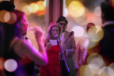 People celebrating and having fun on a party, woman making an announcement - ZEF13573