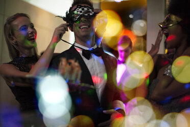 People celebrating and having fun on a costume party - ZEF13582