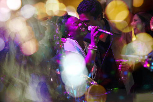 Man embracing singer on a party - ZEF13585