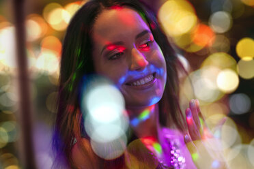 Portrait of smiling young woman on a party - ZEF13588