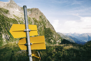 Switzerland, Grisons, Alps, back view of sign post - JUBF00222