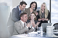 Group of happy with laptop in boardroom - ZEF13606