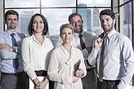 Portrait of confident businessmen and businesswomen in office - ZEF13615