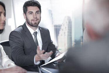 Businessman in office meeting - ZEF13636
