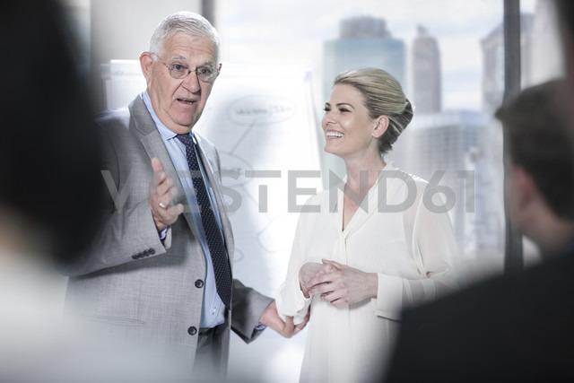 Senior businessman talking in meeting - ZEF13639