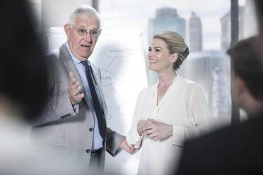 Senior businessman talking in meeting - ZEF13639