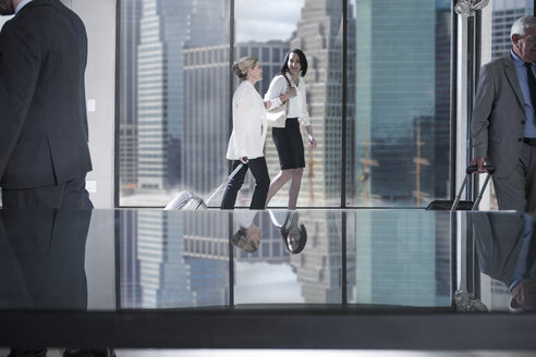 Businesspeople on the move in city office - ZEF13657