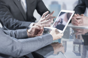 Businesspeople using tablet in meeting - ZEF13666