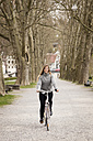 Young woman riding bicycle - MIDF00820