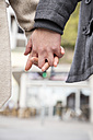 Young couple hand in hand, close-up - MIDF00832