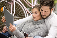 Young couple with documents and cell phone - MIDF00835
