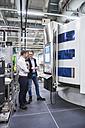 Two men talking in factory shop - DIGF02178