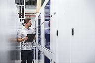 Man examining the system in factory - DIGF02202