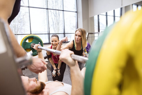 Group of people in gym training weight lifting - HAPF01585