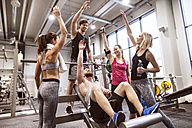 Group of people in gym training weight lifting - HAPF01588