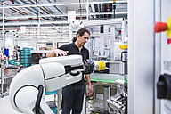 Man with assembly robot in factory - DIGF02228