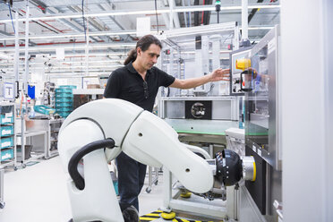 Man with assembly robot in factory - DIGF02231