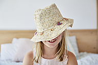 Smiling little girl wearing straw hat - SRYF00269