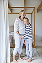 Portrait of little girl with her grandmother  at home - SRYF00290