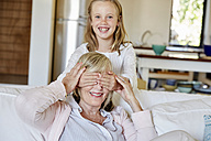 Little girl having fun with her grandmother at home - SRYF00305